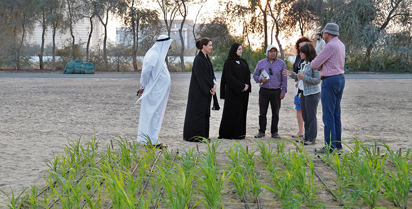H.E. Mariam Almheiri and H.E. Sarah Al Amiri at another demo plot.